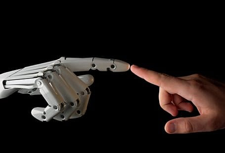 robot and human hands fingers touching